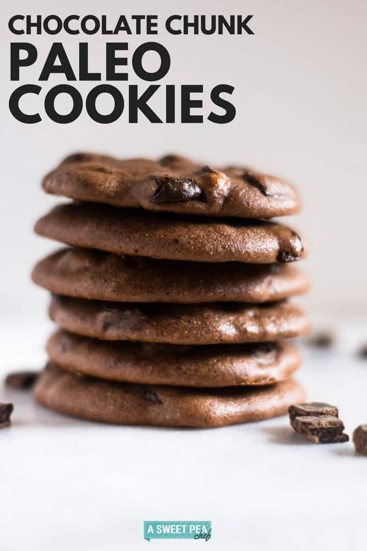 Dark Chocolate Chunk paleo cookies stacked on top of each other, setting next to dark chocolate morsels.