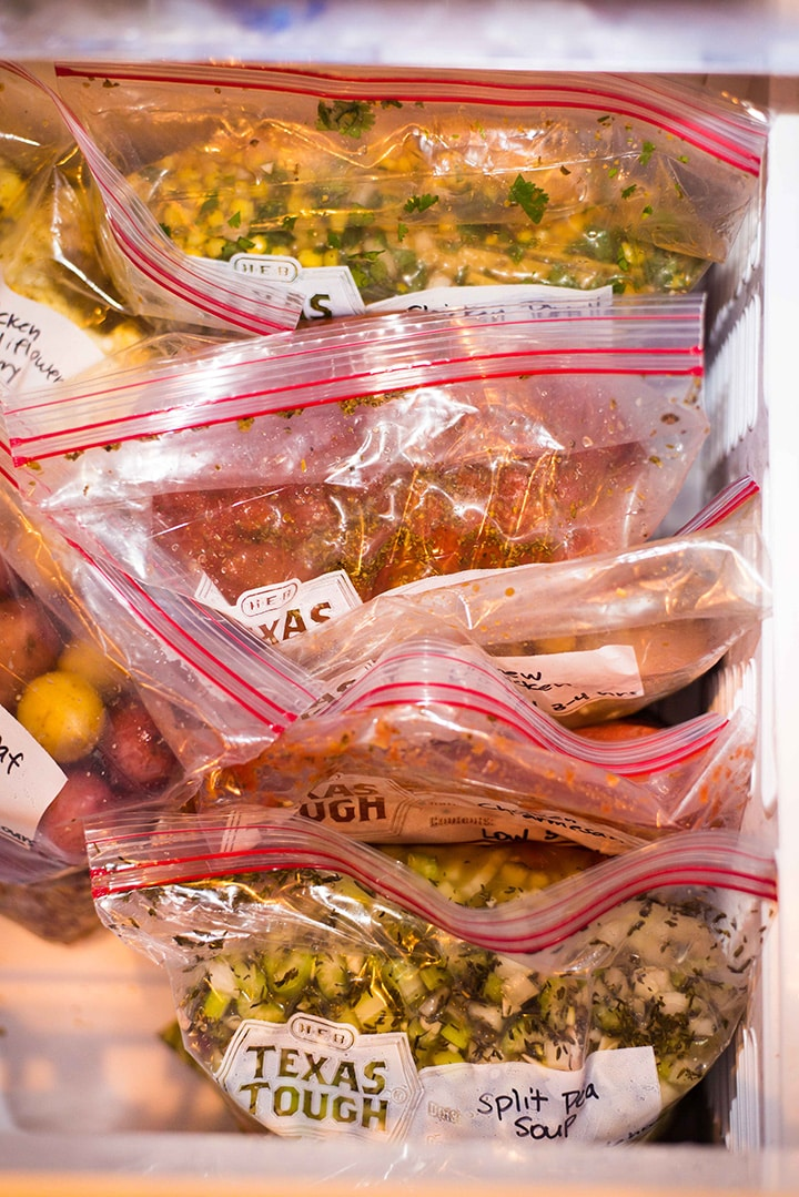Inside view of a freezer that shows the slow cooker freezer meals that are being frozen for later.