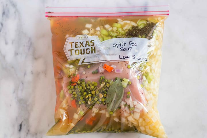 Ziploc bag filled with contents for split pea soup freezer meal, ready to be frozen.