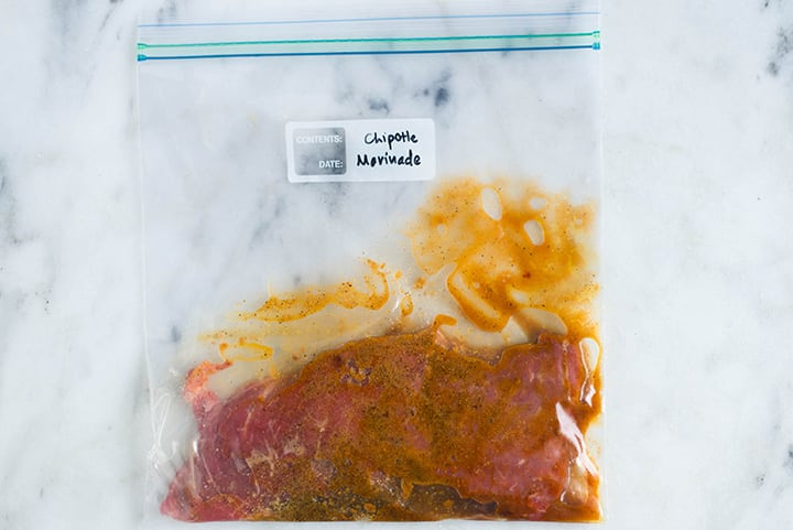 Sealable freezer bag with steak and the Chipotle Marinade, marinating and ready to cook.