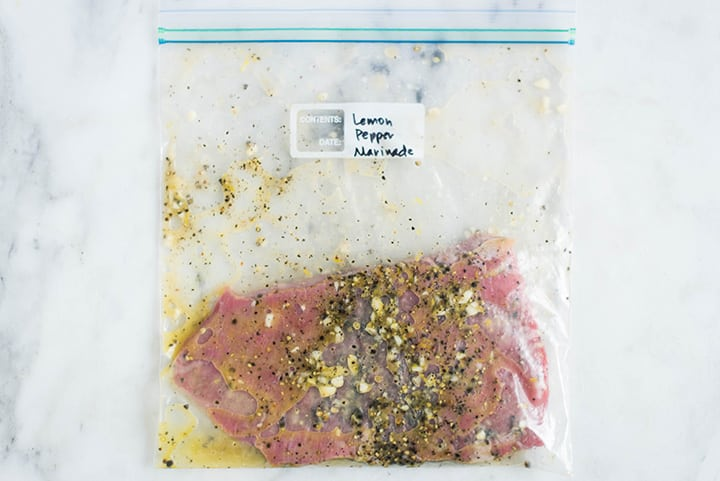 Sealable freezer bag with steak and the Lemon Pepper Marinade, marinating and ready to cook.