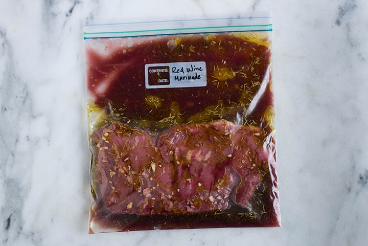 Sealable freezer bag with skirt steak and Red Wine Marinade, marinating and ready to cook.