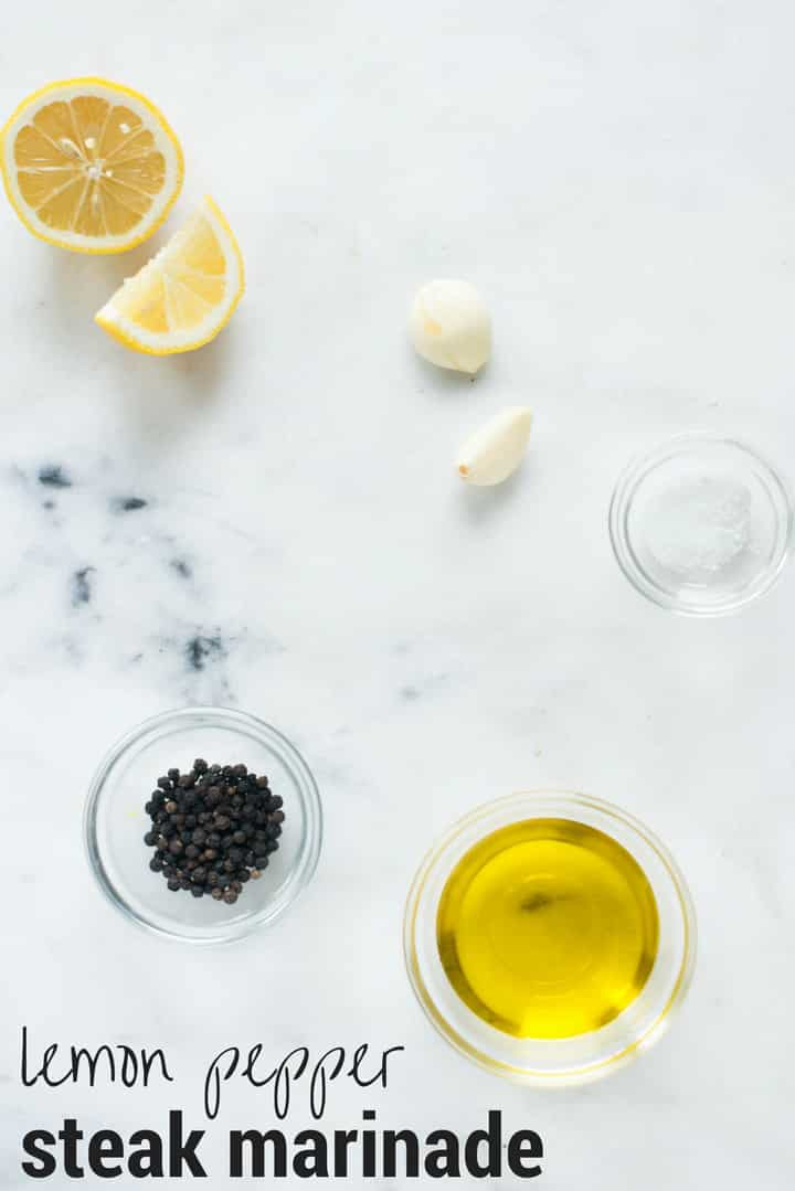 Ingredients separated for the Lemon Pepper Marinade, including lemon zest, freshly squeezed lemon juice, minced garlic cloves, crushed black peppercorns, sea salt and olive oil.