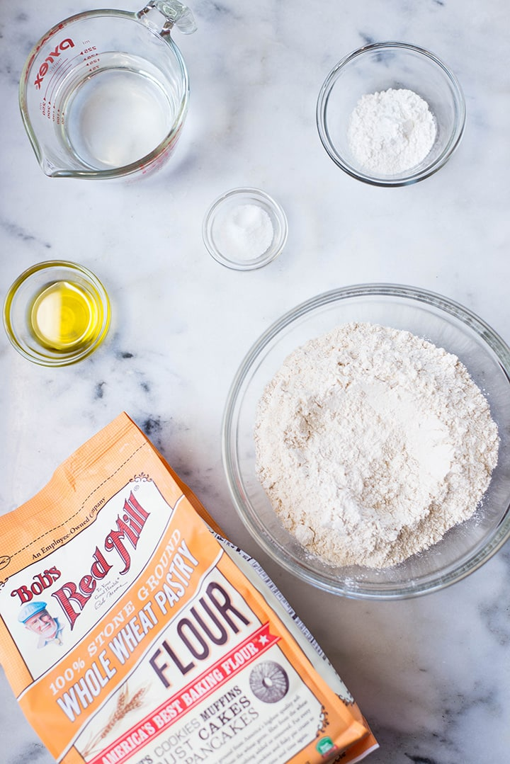 Ingredient needed to make homemade whole wheat pizza crust for the best bbq chicken pizza, which include whole wheat pastry flour, olive oil, baking powder, sea salt, and water.