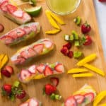 These fruity Kiwi Strawberry Spring Rolls are a burst of flavor and are super addicting, especially when dipped into the Honey Lime Sauce. A perfect summer dessert! One of the five healthy spring roll recipes.