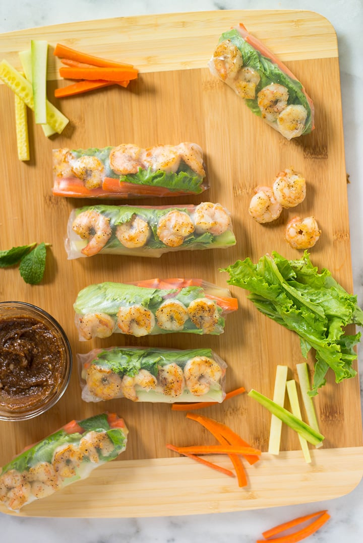Individual recipe image of one of the healthy spring roll recipes, which is the shrimp spring rolls. Cooked shrimp are one of my favorite protein choices and they make a great flavor and texture combo when paired up with veggies. Try this healthy Shrimp Spring Rolls recipe with a Spicy Almond Dipping Sauce and see for yourself!