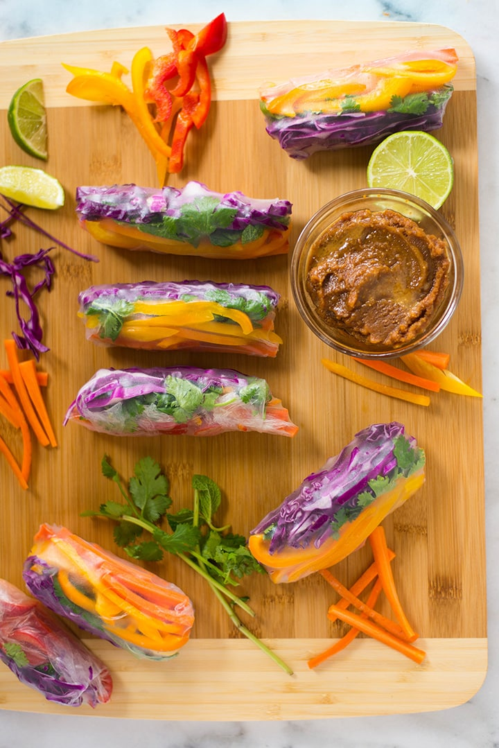 One of the 5 healthy spring roll recipes, which is the Rainbow Spring Roll. Eat the rainbow with these healthy Rainbow Spring Rolls packed with a bunch of fresh crunchy veggies. Add some spice by dipping them into the Ginger Peanut Sauce!
