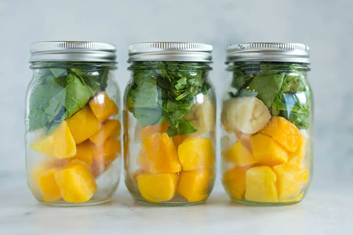 View of one of the breakfasts for the meal plan for weight loss, which is mango green smoothie, stacked in a mason jar.