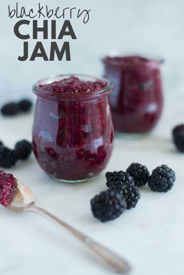 A side image of a glass jar filled with Homemade Blackberry Chia Jam made from fresh blackberries, chia seeds, and raw honey.