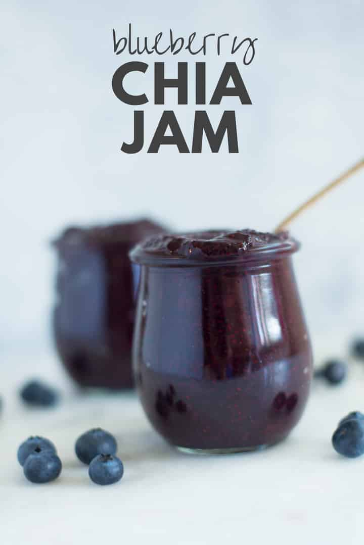 A side image of a glass jar filled with Homemade Blueberry Chia Jam made from fresh blueberries, chia seeds, and raw honey.