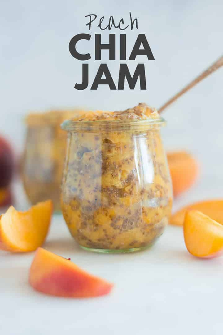 A side image of a glass jar filled with Homemade Peach Chia Jam made from fresh peaches, chia seeds, and raw honey.