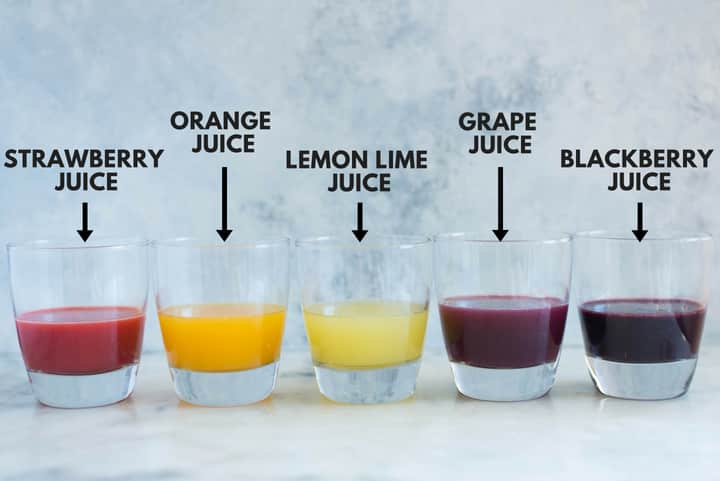 A side image of five glasses each with juice made from fresh fruit including strawberry juice, orange juice, lemon lime juice, grape juice and blackberry juice for the Caffeine-free Homemade Sodas.