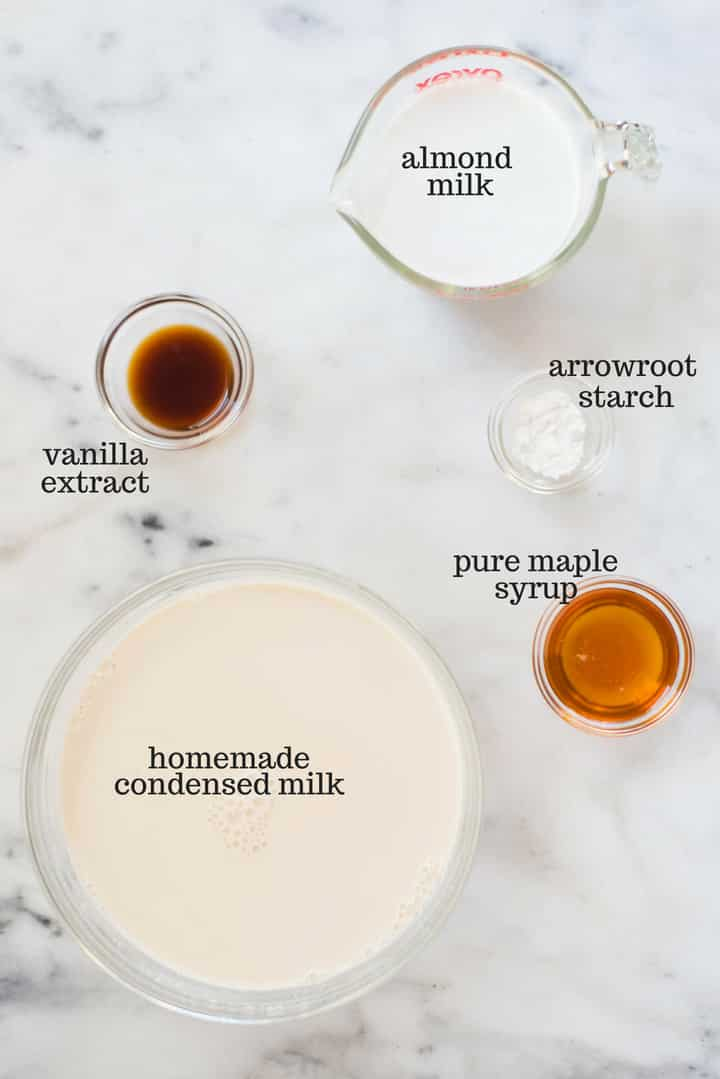An overhead image of a kitchen counter with all the ingredients for homemade coffee creamer including