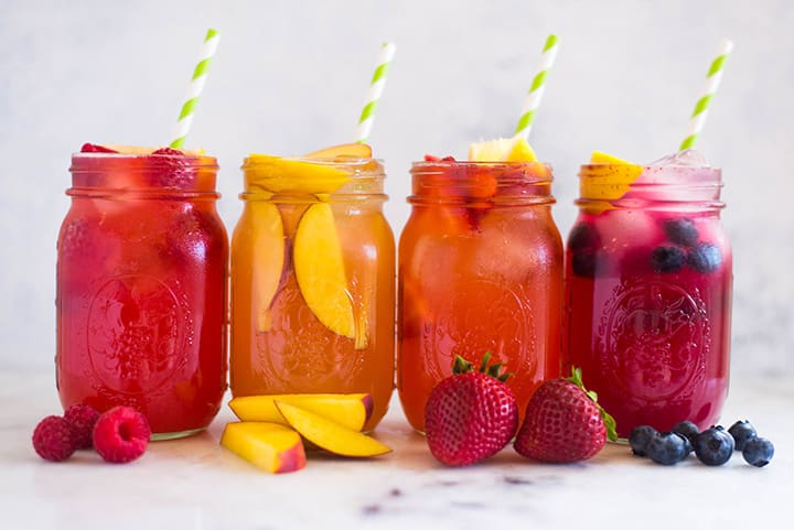 A side image of a mason jar filled with Easy Homemade Strawberry Lemonade made from fresh