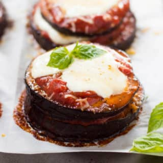 A close up image of Baked Eggplant Parmesan, made with roasted eggplant, homemade tomato sauce, mozzarella and grated parmesan, before placing it in the oven.
