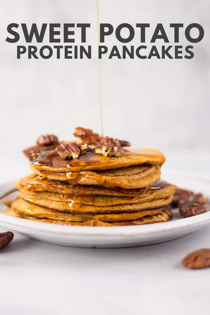A side image of a stack of Sweet Potato Protein Pancakes made with sweet potatoes, egg whites, vanilla protein powder, ground flaxseed, baking powder, ground cinnamon and vanilla extract, topped with chopped pecans and drizzled with pure maple syrup.