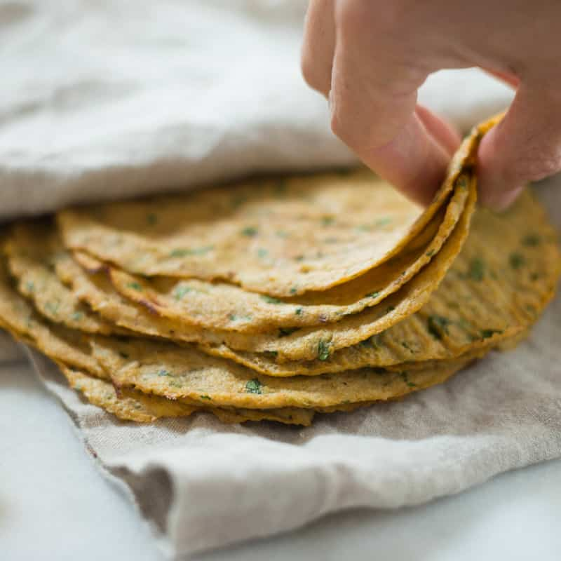 A close up image of freshly made Cauliflower Tortillas made with fresh cauliflower, eggs and seasonings.
