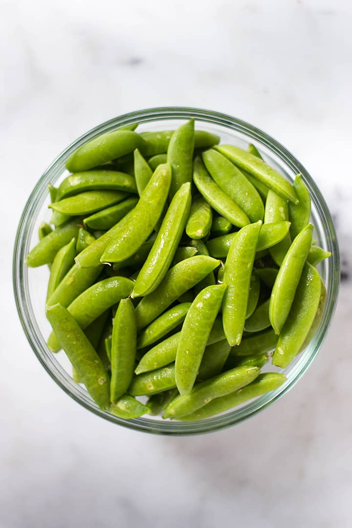A bowl of sugar snap peas ready to be used to make Sugar Snap Peas with Lemon.