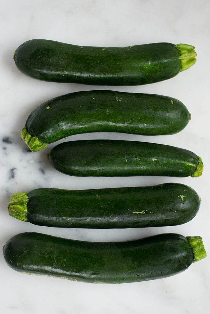 5 zucchinis that will be used to make Healthy Chocolate Zucchini Bread.