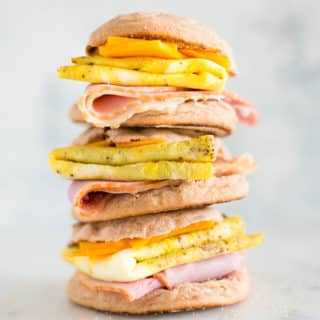 A tower made of 3 Make-Ahead Freezer Breakfast Sandwiches place on top of each other.