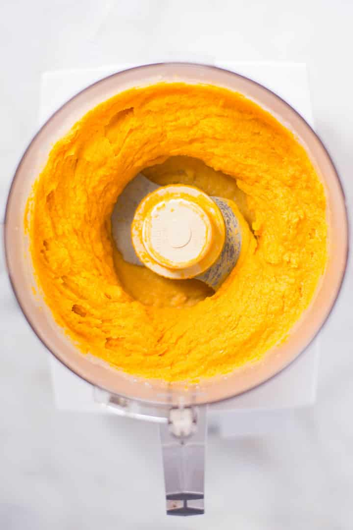 Freshly made Healthy Sweet Potato Hummus in the food processor.
