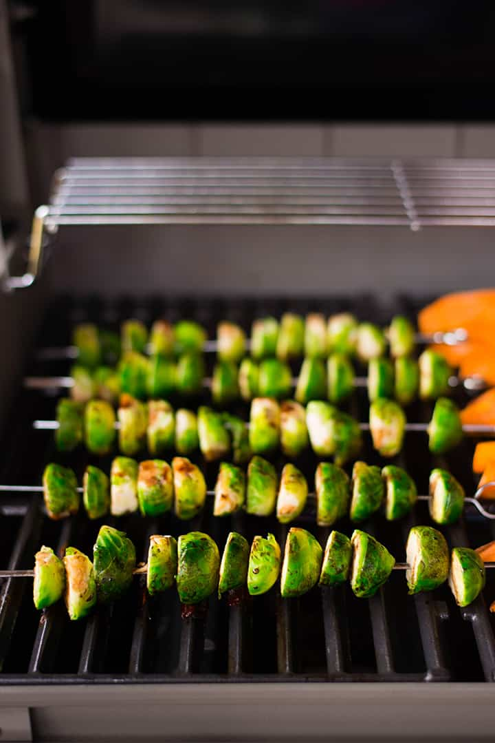 Brussel sprouts skewers cooking on the Webber grill.