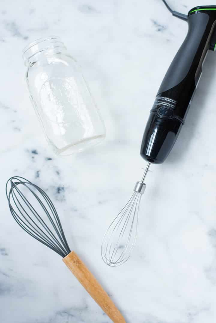 A whisk, an immersion blender or a mason jar can be used to make a homemade latte without an espresso maker.