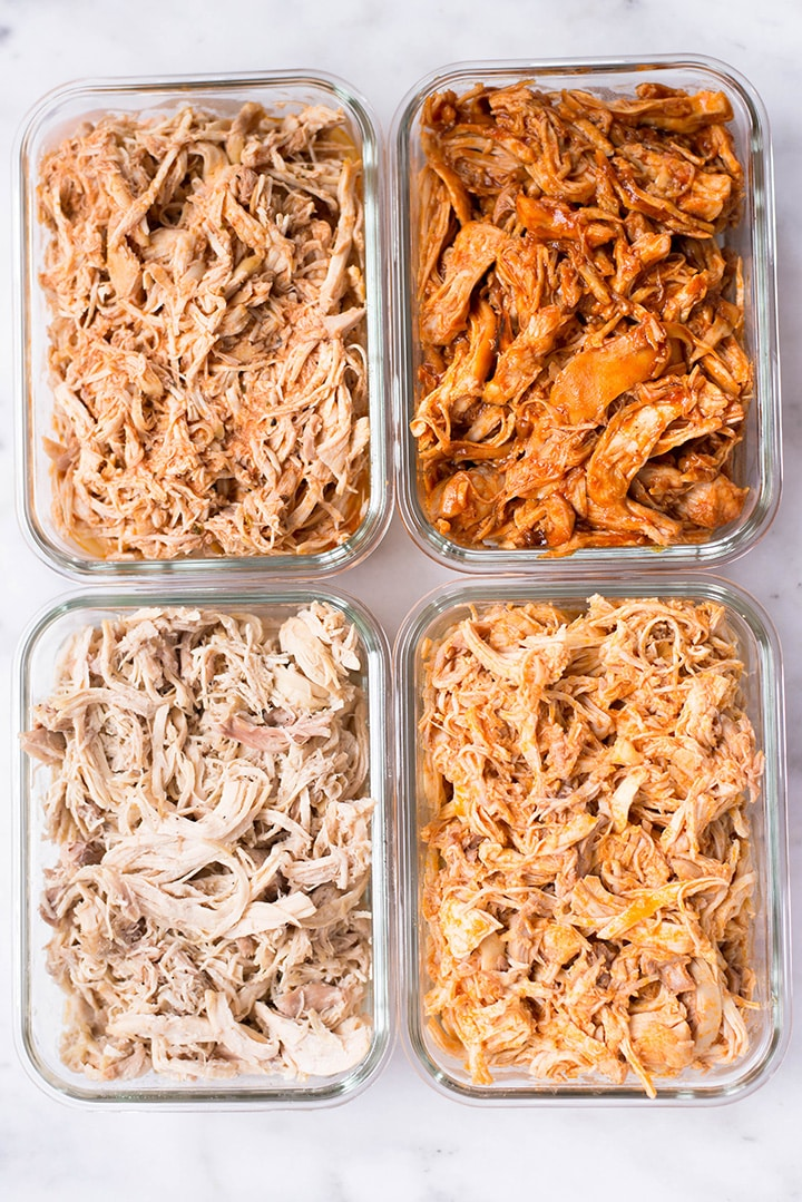 Overhead image of four glass containers containing 4 flavors of Slow Cooker Shredded Chicken Meal Prep, a healthy macro meal choice.