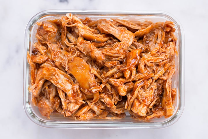 Slow Cooker BBQ Shredded Chicken in a meal prep container.