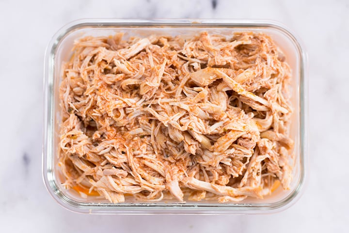 Slow Cooker Mexican Shredded Chicken in a meal prep container.