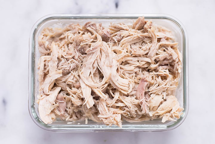 Plain Slow Cooker Shredded Chicken in a meal prep container.