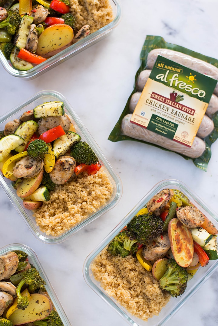 Vie from the top of 4 meal prep containers filled with quinoa, roasted veggies and sausage. Next to the meal prep containers there's a package of healthy sausage from Al Fresco.