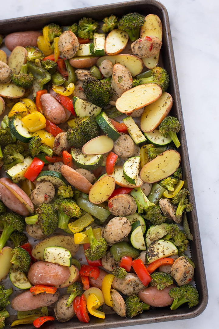 Top view of the roasted roasted vegetables and sausage.