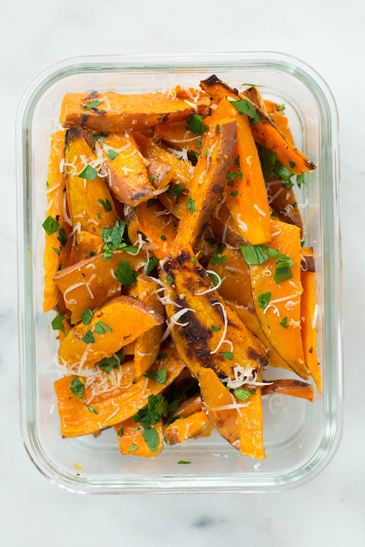 Meal prep container with garlic & herbs sweet potato fries.