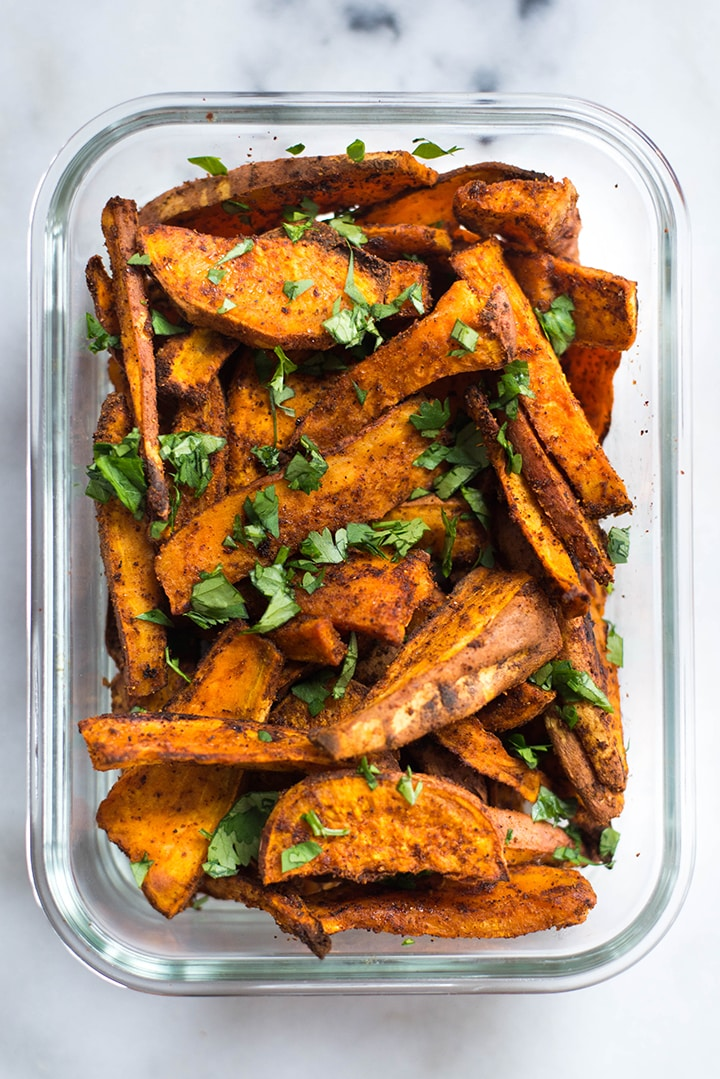 Meal prep container with spicy chile sweet potato fries.