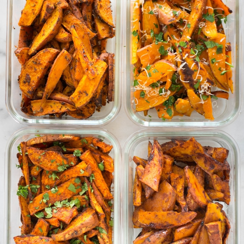 Overhead image of four meal prep containers with sweet potato fries, prepped and ready to eat as part of a superfood meal plan.