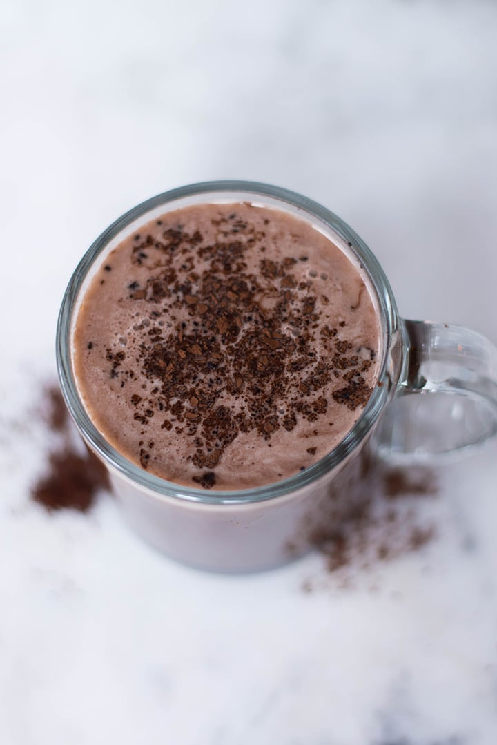 Mocha latte garnished with cocoa powder in a mug ready to be enjoyed.