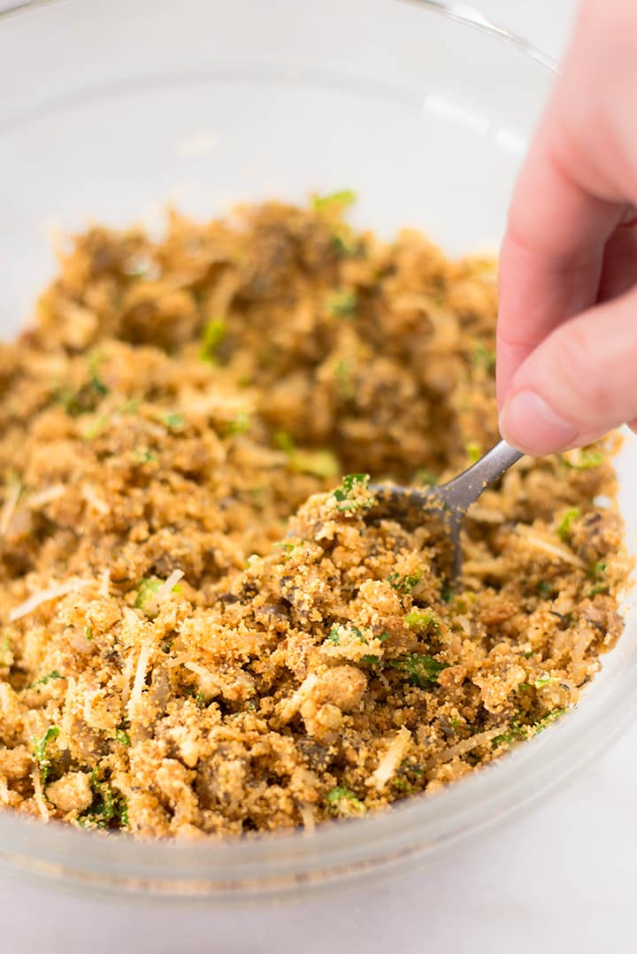 Close up of the stuffing for the garlic stuffed mushrooms in a mixing bowl.