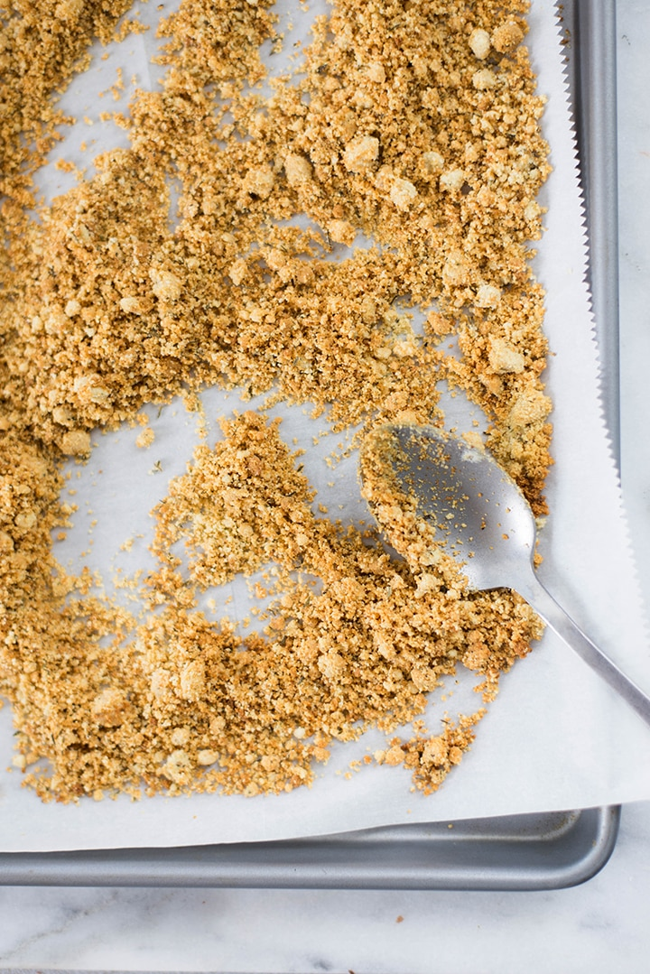 Baked almond meal on baking sheet that will be used to stuff mushrooms.