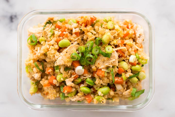One of the Healthier Restaurant Takeout Dishes made at home - Chicken Cauliflower fried Rice in a meal prep container.