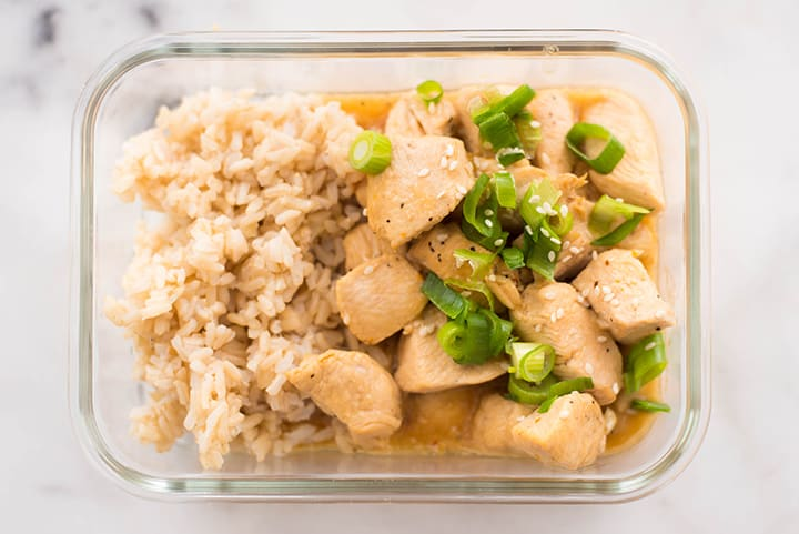 One of the Healthier Restaurant Takeout Dishes made at home - Orange Chicken in a meal prep container.
