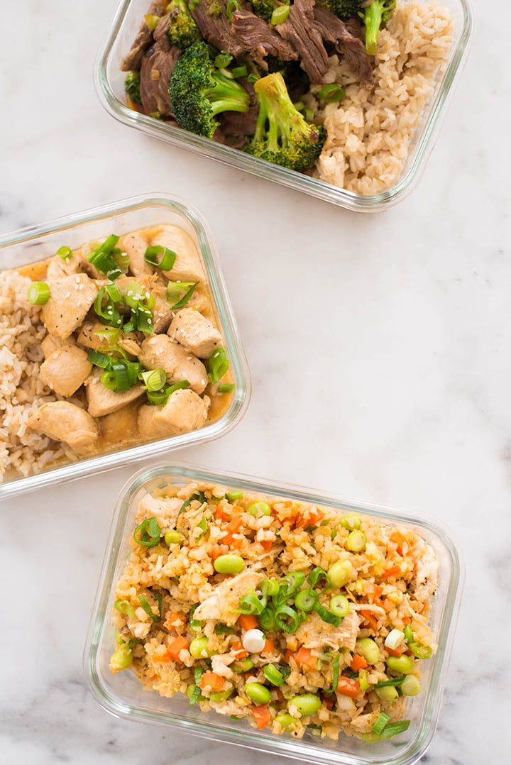 Top view of the Healthier Restaurant Takeout Dishes made at home in meal prep containers.