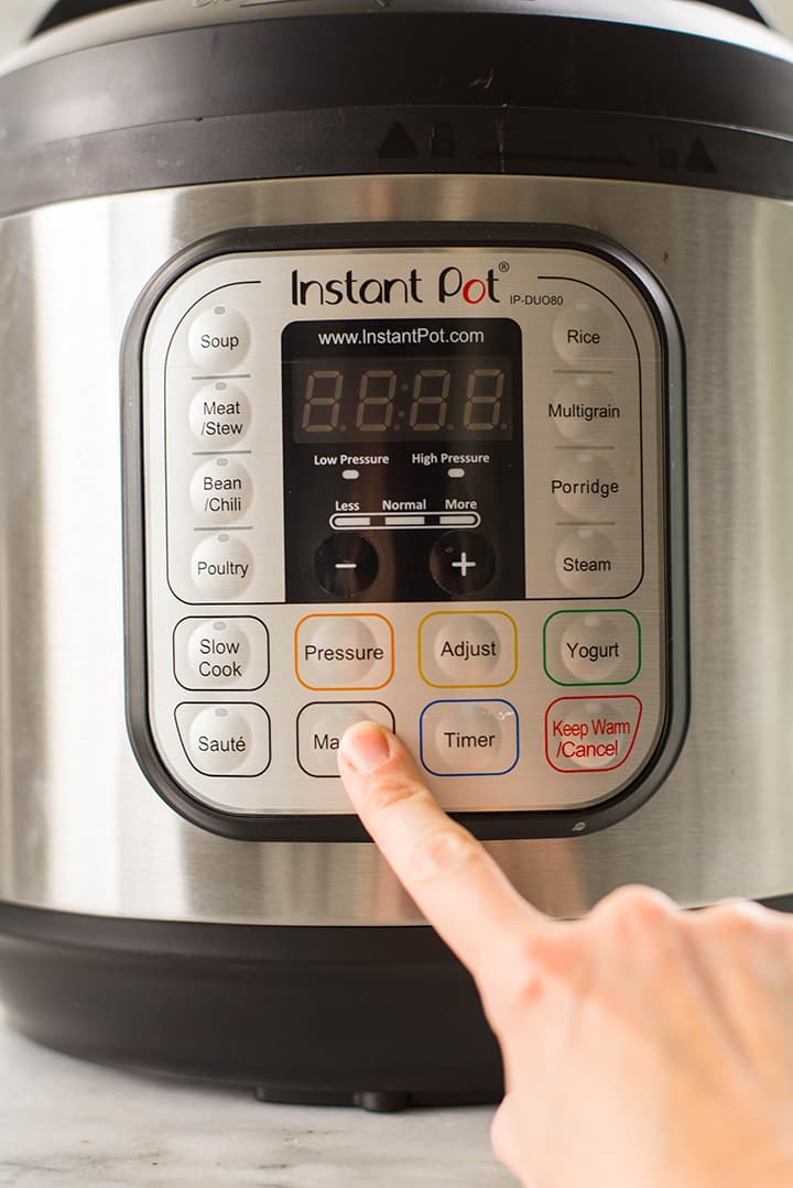 Manually setting the instant pot to cook the black beans.