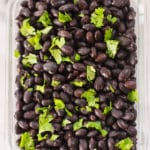 Top view of plain black beans in a meal prep container.