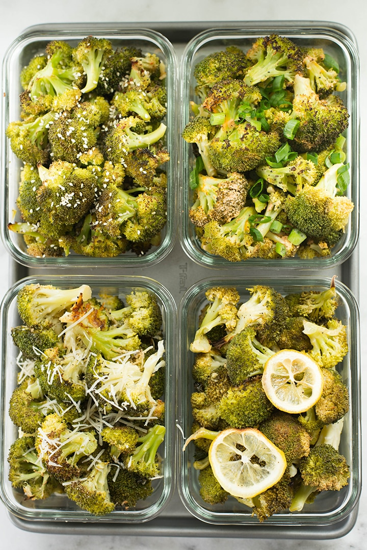 Close up top view of meal prep containers filled with 4 different types of roasted broccoli.
