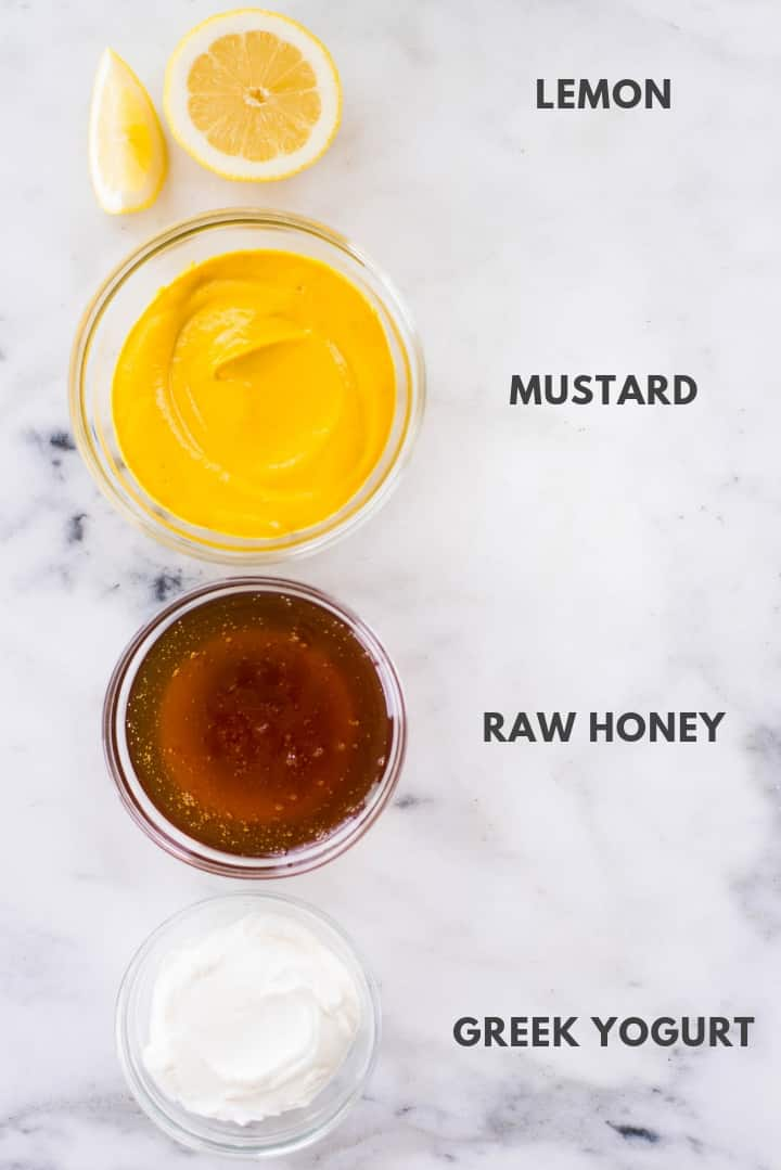 Top view of ingredients for Healthy Honey Mustard Dressing Recipe in small mixing bowls.