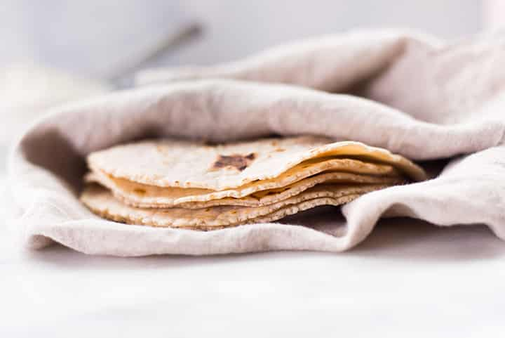 Close up side view of freshly made cassava flour tortillas.
