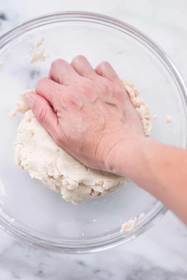 Kneading the dough for the cassava tortillas.