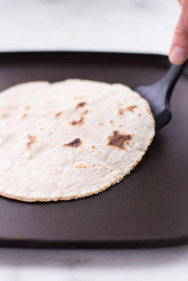 Cooking cassava flour tortilla on the griddle.