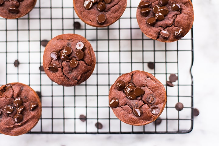 Top view close up of the healthy chocolate muffins placed on the cooling rack.
